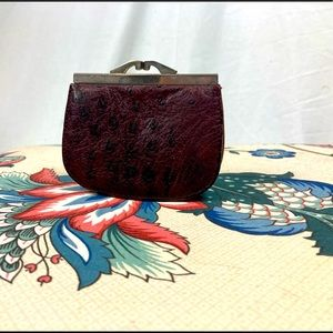 Vintage leather change purse with metal closure